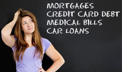 woman scratching head looking at debts