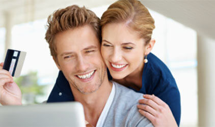 couple at laptop with credit card